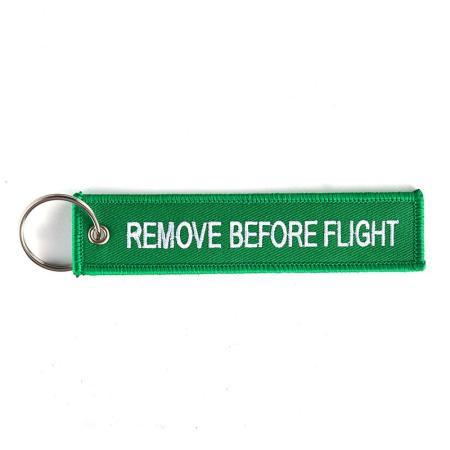 Schlüsselanhänger REMOVE BEFORE FLIGHT grün
