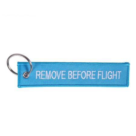 Schlüsselanhänger REMOVE BEFORE FLIGHT hellblau