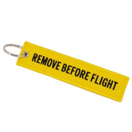 Schlüsselanhänger REMOVE BEFORE FLIGHT gelb