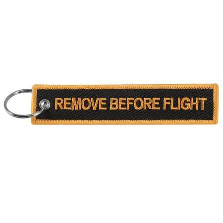 Schlüsselanhänger REMOVE BEFORE FLIGHT orange