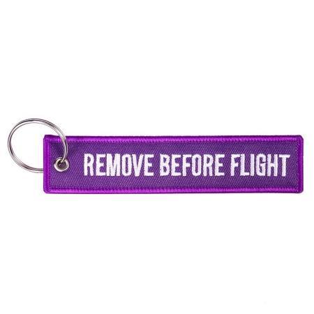 Schlüsselanhänger REMOVE BEFORE FLIGHT violett